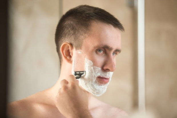 man shaving his cheek, blog image for 6 Mistakes to Avoid with Your New Safety Razor by shave valet