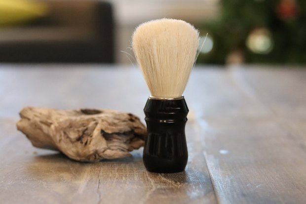 A boar hair bristle shaving brush with a black injection moulded handle. shave valet; shave valet saskatoon; saskatoon; wet shaving; wet shave; traditional wet shaving; shaving brush; boar shaving brush; boar hair shaving brush; boar shave brush